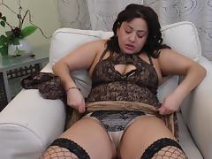 Chubby dark-haired chick pushes the black dildo deep into her pussy