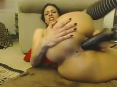 webcam gal smashes her cunt and asshole with toys