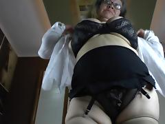 Chubby old gal with huge natural tits toys her snatch