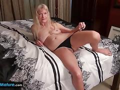 Mature blonde rubs her warm pussy