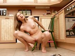 Skinny girl and her veggie fucking solo in the kitchen