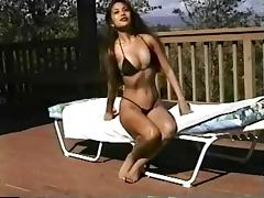 Long haired swimsuit model posing outdoors for your pleasure porn tube video
