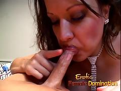 Dominatrix sucks her slaves cock while toying with his ass