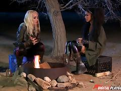 Smooth-looking girls having the lesbian fun by the campfire