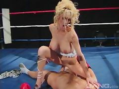 Classy babe takes the dick up both of her holes in the boxing ring