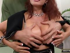 Gorgeous mature redhead sucking off a cock for a facial