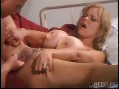 Blonde nurse with big honkers does a muscular brute in bed