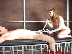 Wild redhead with big perky tits torturing a stranger in her playroom