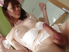 Asian shemale in bunny costume puts suction cups on her nipples