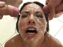 Asian takes on lots of cocks in a blowbang before they cum on her