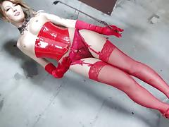 Tight red latex corset on an elegant Japanese tranny