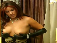 Redhead wearing leather gloves stimulates her hot pussy