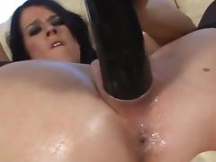 Dark-haired chick pushes the most favorite of her toys into the pussy