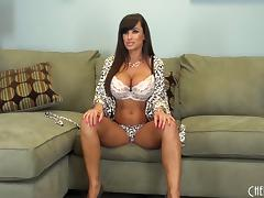 Busty beauty Lisa Ann strips and spreads her legs to masturbate