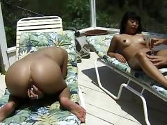 Asian girls sitting poolside and pleasuring their pussy