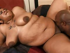 Humongous chocolate lady is happy to have a taste of the black dick