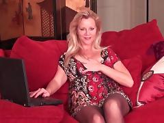 Blonde MILF masterbates her wet pussy. porn tube video