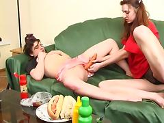 Pigtailed and hot girls get messy inserting food in their twats in this lesbians scene