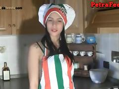 Italian damsel removes her shoes to quench her demanding foot fetish in the kitchen