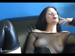 Sexy woman smokes on black sofa in hot style porn tube video