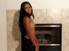 Petite Asian girl with small tits shows her body by the fireplace