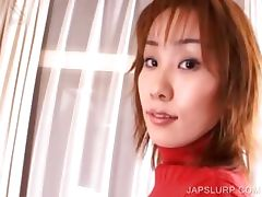 Japanese cutie shows sexy assets
