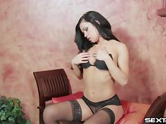 Sexy cowgirl moaning in ecstasy as she drills her pink slit with a toy