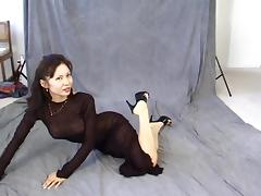 Elegant Asian in a floor length sheer grown that clings to her body tube porn video