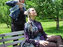 Girls wash their hair outdoors on a sunny day