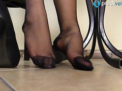 Kinky redhead puts on the pantyhose and exhibits her sexy feet porn tube video