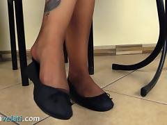 Dark-haired cutie smokes a cigarette and exposes her attractive legs porn tube video