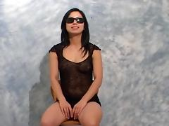 Lady in a lace teddy takes out her titties to tease us