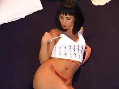 Hottie with a nice tight body vibrates her pussy with a toy