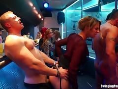 Busty clothed bitches get fucked at an orgy in a nightclub