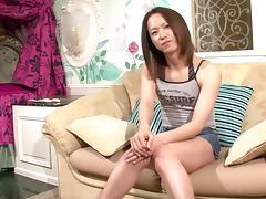 Cock stroking Asian tranny gives a dildo footjob