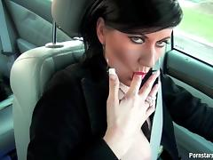 She reaches over an gives a handjob while they drive down the street porn tube video