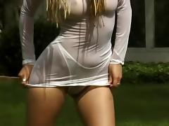 Solo babe with big tits plays with her long braided hair outdoors