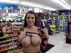 Impressive brunette is ready to flash with her tits in the supermarket porn tube video
