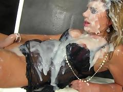 Leggy blonde in high heels gets covered in slime at a gloryhole
