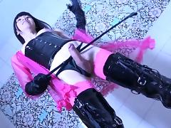 Latex boots and a hot corset on the dick stroking Japanese girl