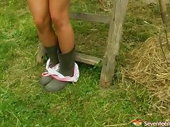 Tantalizing amateur moans erotically while masturbating with a toy outdoors