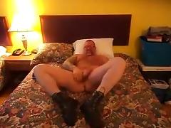 Jerking my cock wearing boots