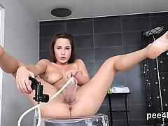 Exceptional sweetie is peeing and masturbating shaved pussy