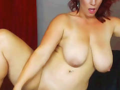 Sexy Redhead BBW MILF dildoes while standing porn tube video