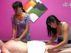 Horny Asian babes turn a massage session into a thrilling ffm fucking tube porn video