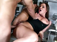 Mom in the gym sits her cunt on a rock hard dick