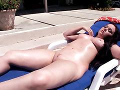 Nice curves on a bikini girl masturbating by the pool