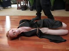 Cute redhead is tied up and attacked in a BDSM way tube porn video