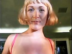 Short haired blonde sticks her fingers in her pussy then taste her pussy juice