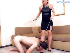 Tight dress on a hot mistress feeding the slave her sexy feet
